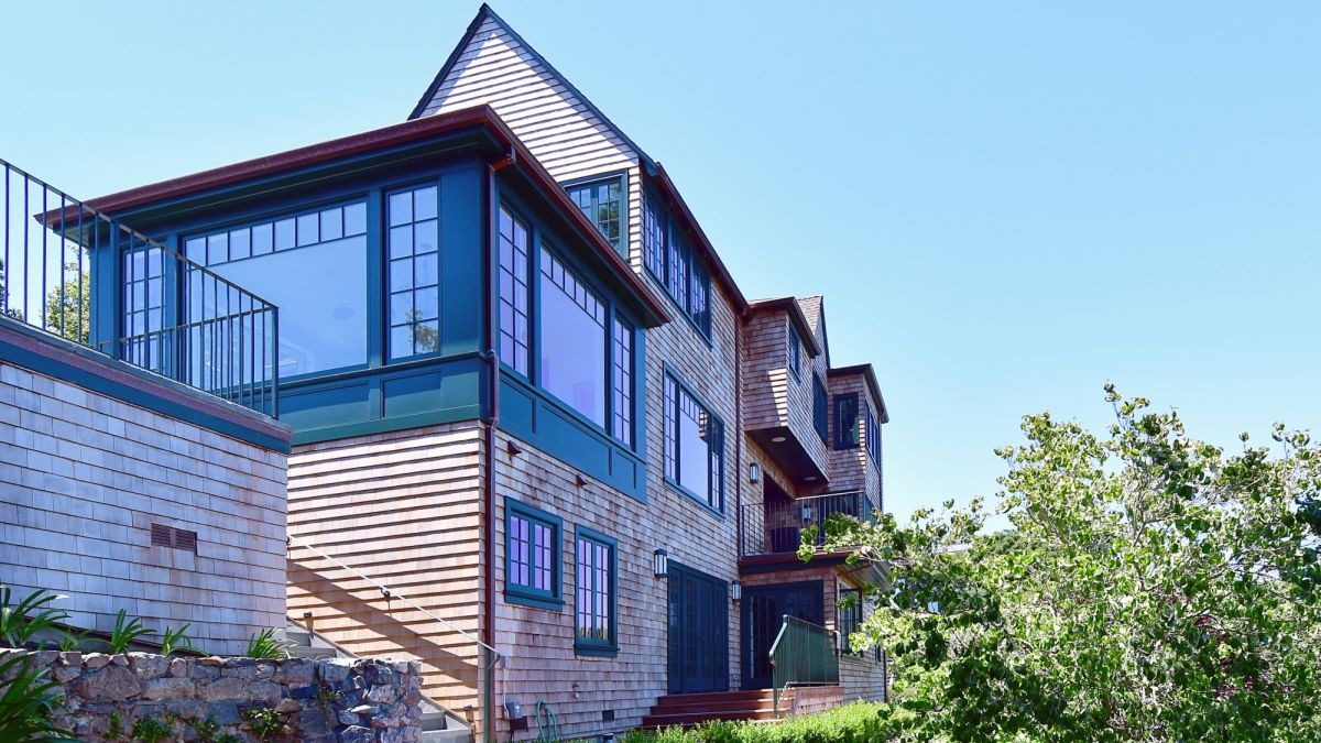 Side of Golden Gate remodel with green accented windows.