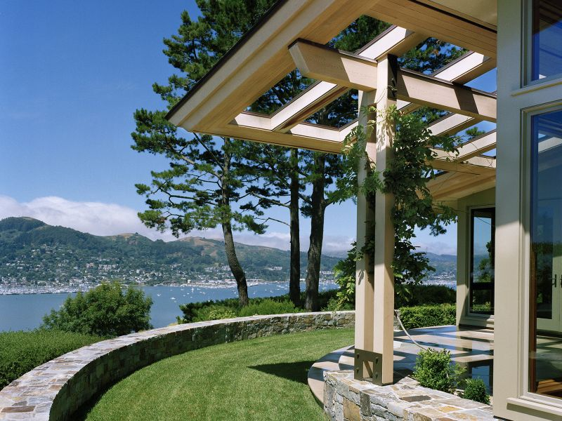 Side of home with grassy area overlooking the water from the Bay.