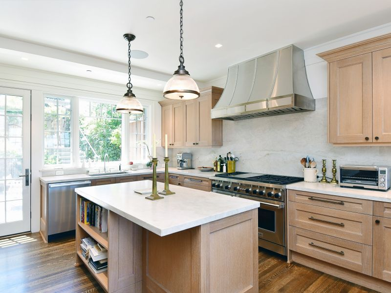 Golden Gate remodeled kitchen with wooden cabinets and white marble countertops.