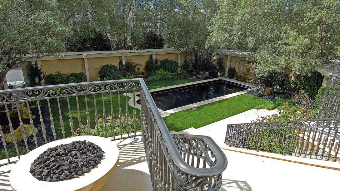 View of backyard from top of stairs.
