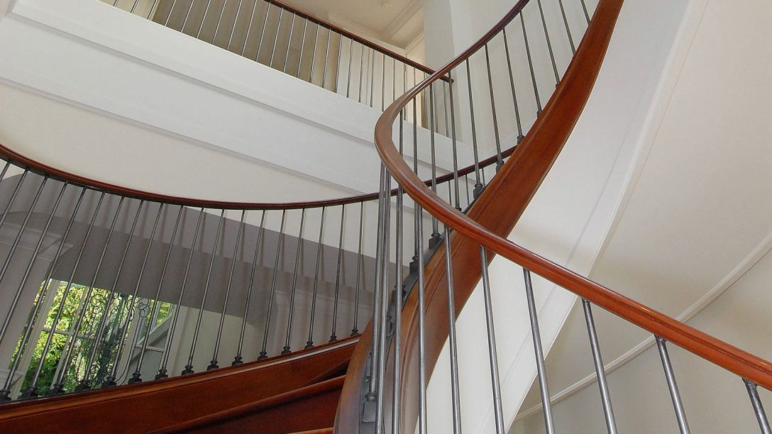 Metal railing of staircase in Spiral Belvedere home.
