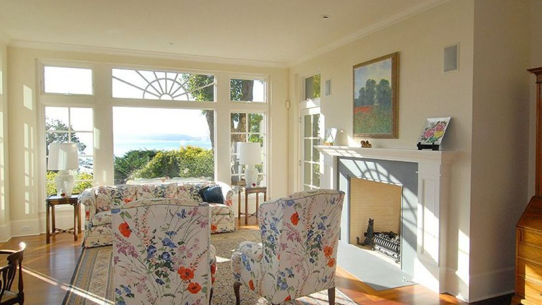 White floral chairs in sitting area of home.
