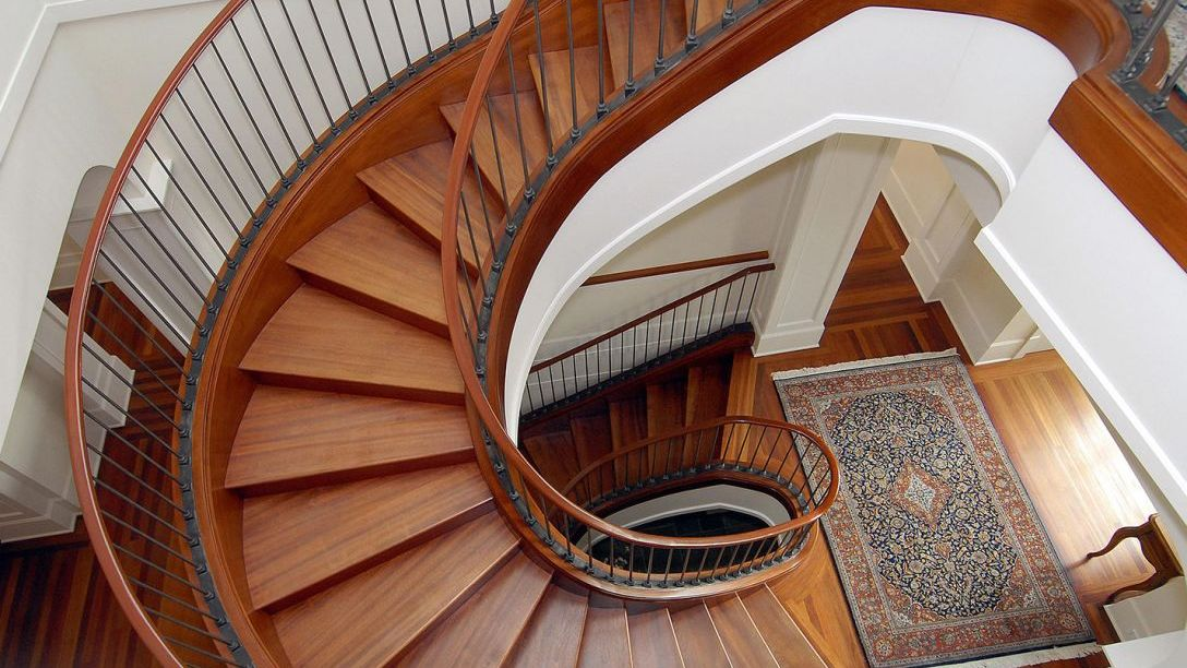 View of spiral wood staircase from above.