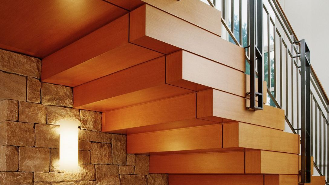 Underneath wooden staircase.