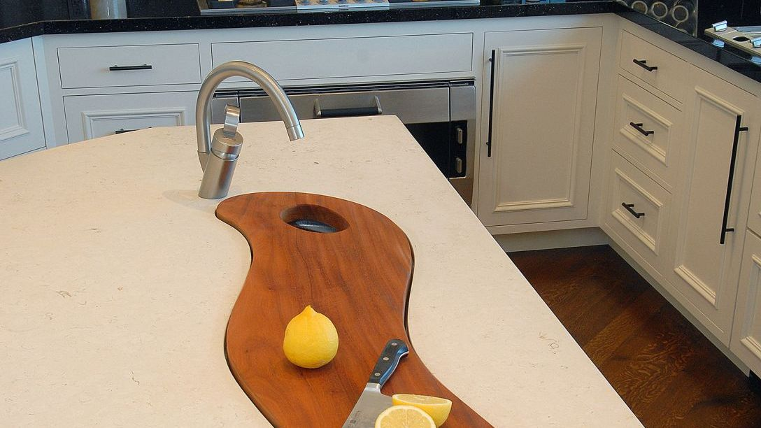 Close up of kitchen island with wood cutting board.