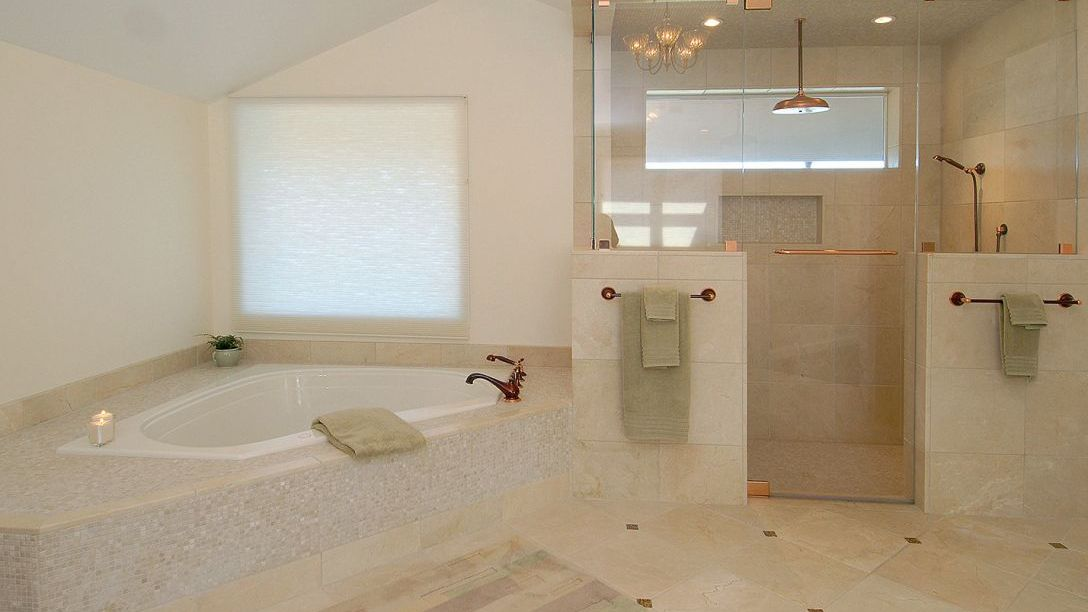 White bathtub and separate walk-in shower.