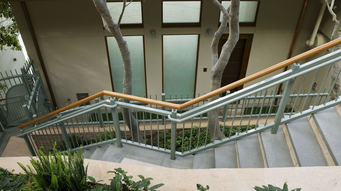 Turquoise and wood staircase outside.