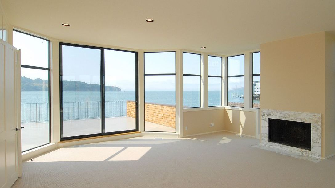 Empty room of Tiburon waterfront remodel with views of the water.