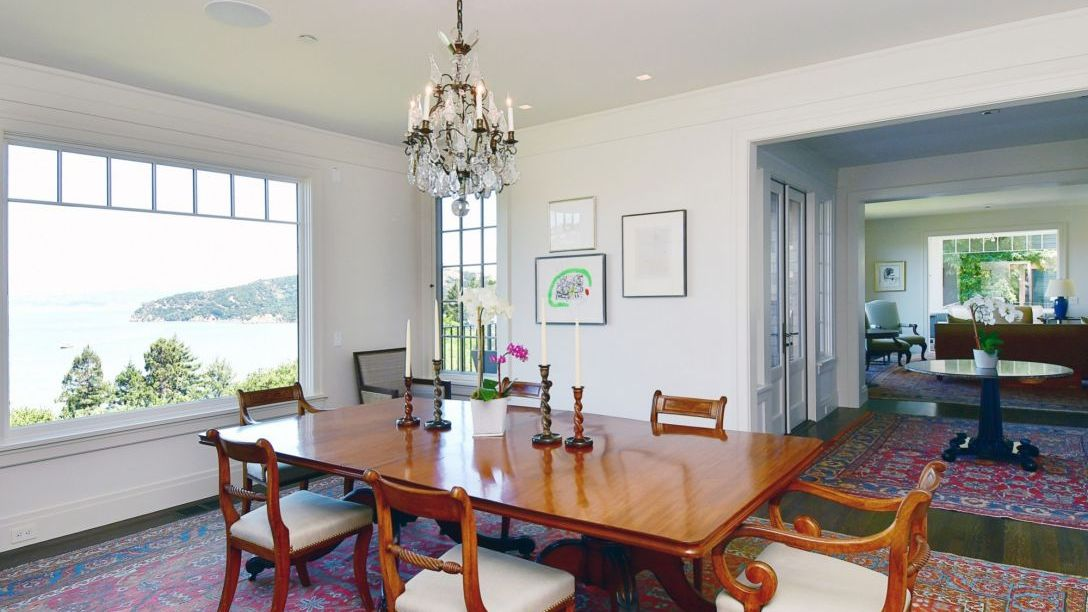 Wood dining room table overlooking Bay area.