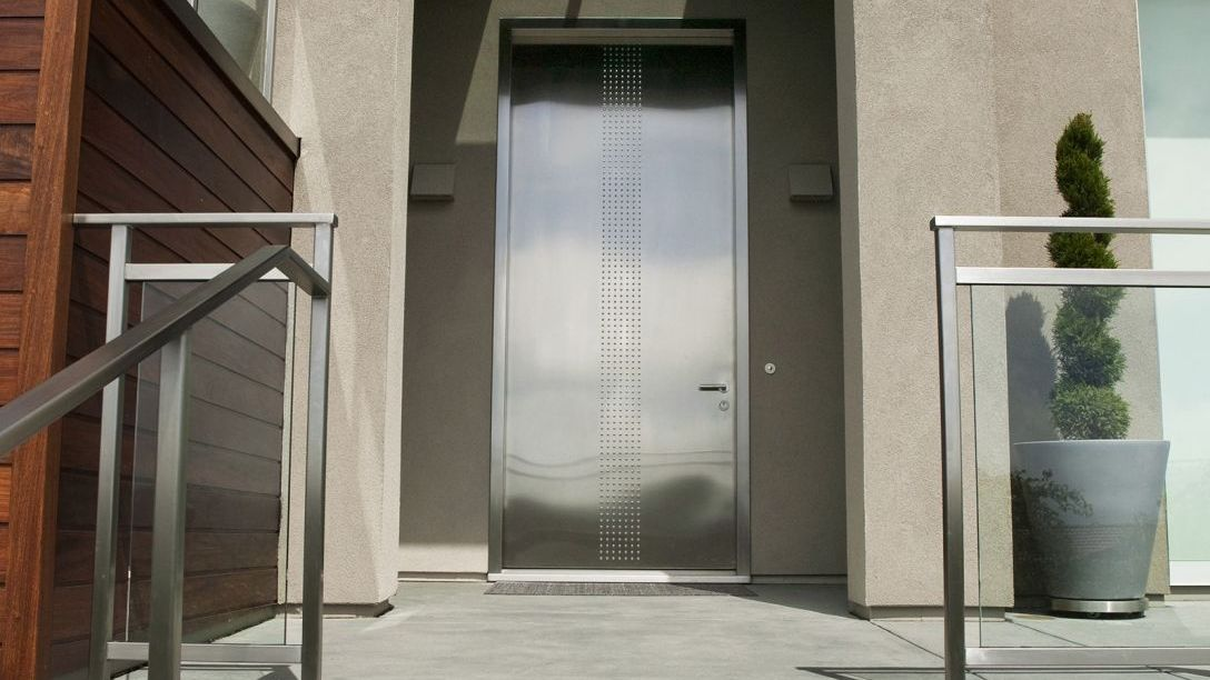 Stainless steel front door of Tiburon Transformation Remodel.