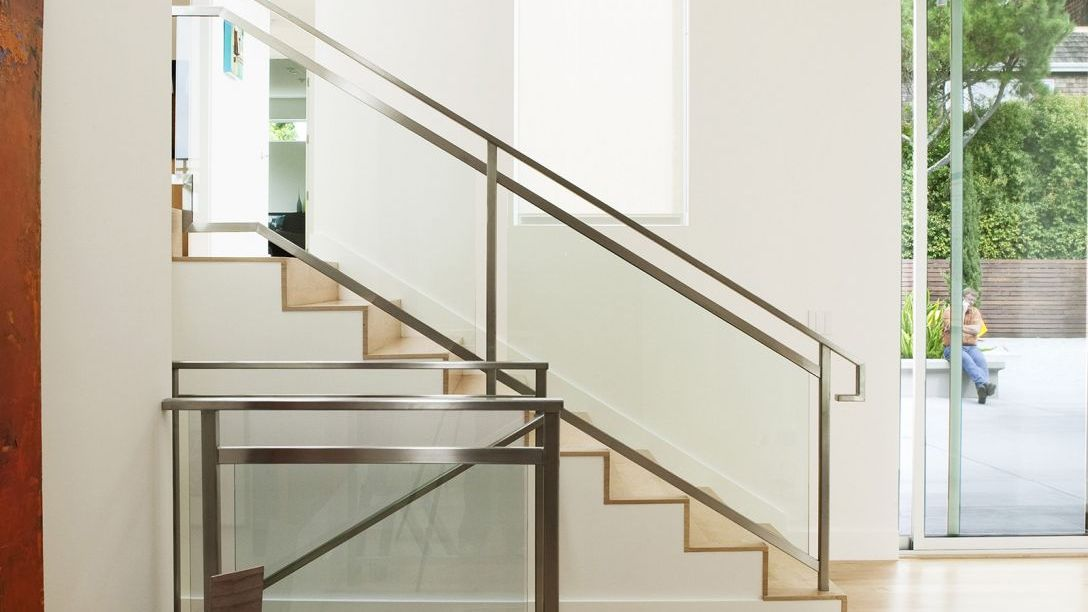 Stairs with wood steps and steel railing in Tiburon Transformation Remodel.