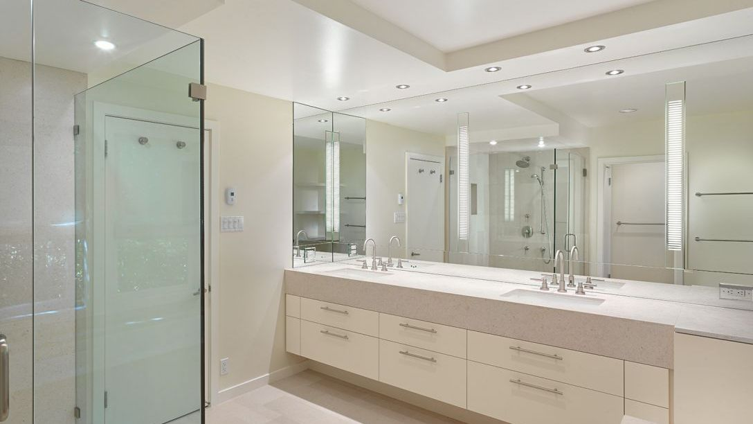 Bathroom of Belvedere Modern remodel with  walk-in shower and twin sinks.