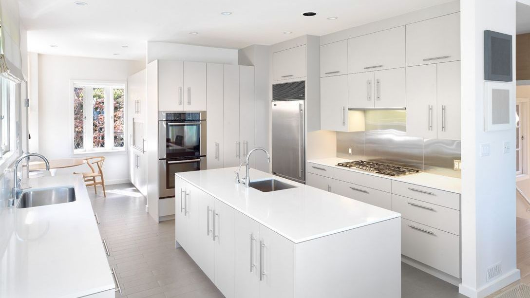 Belvedere Modern remodel kitchen with all white cabinets and drawers and grey tile floor.