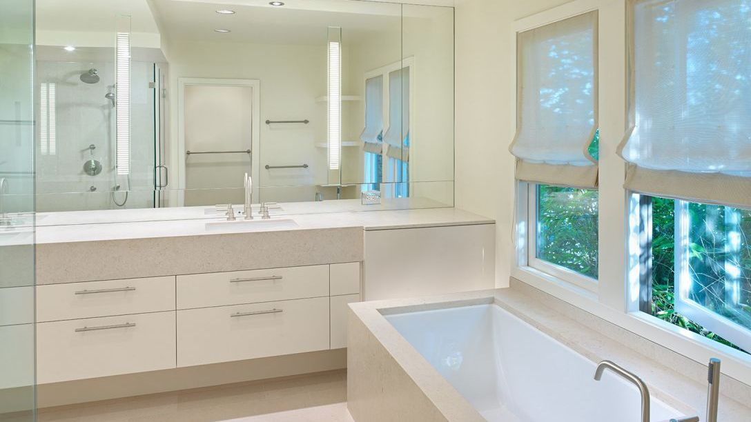 Bathroom of Belvedere Modern remodel with bathtub, walk-in shower, and twin sinks.