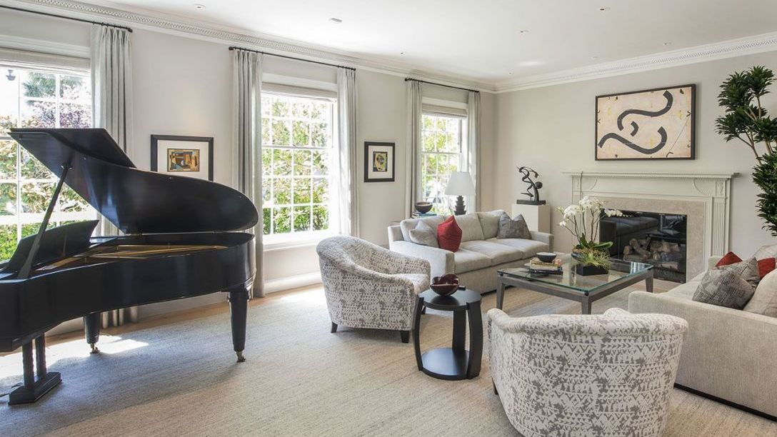 Seating area with cushions and Grand Piano.