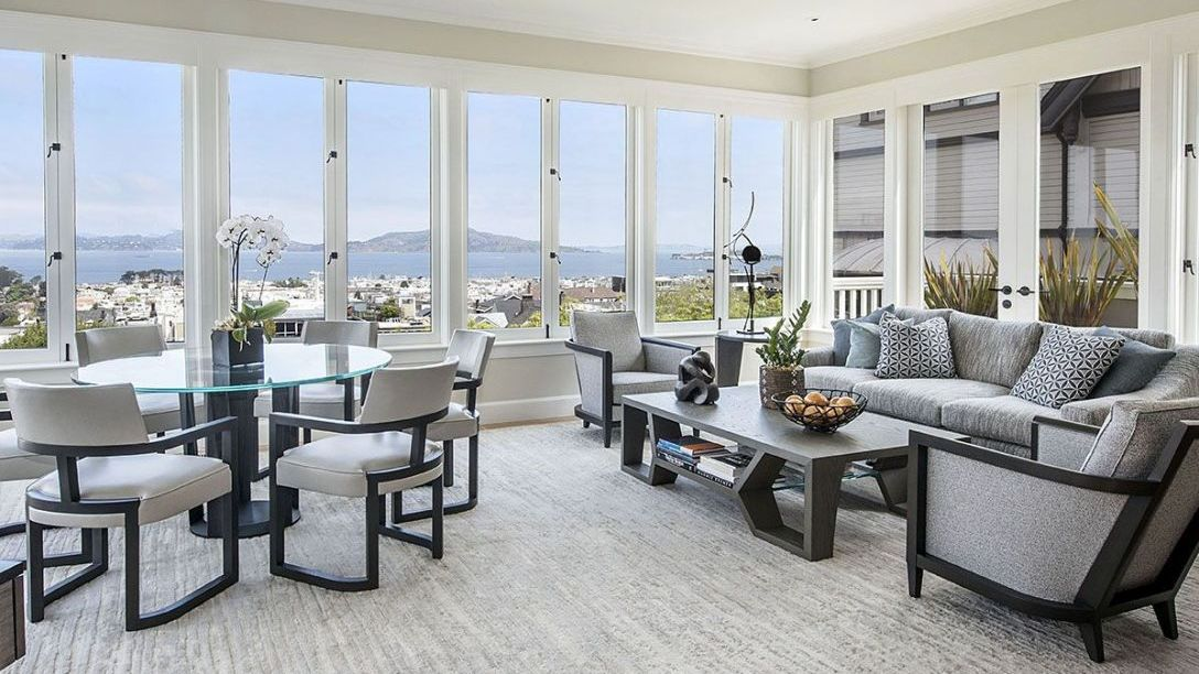 Living room with windows overlooking the Bay.