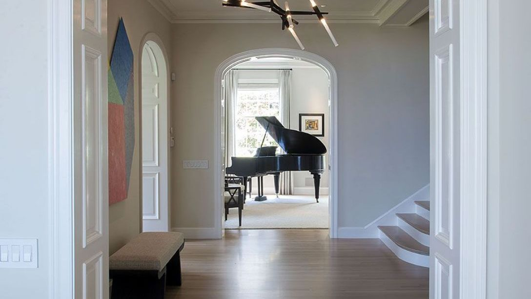 Hallway of Peninsula Heights remodel with grand piano in the distance.