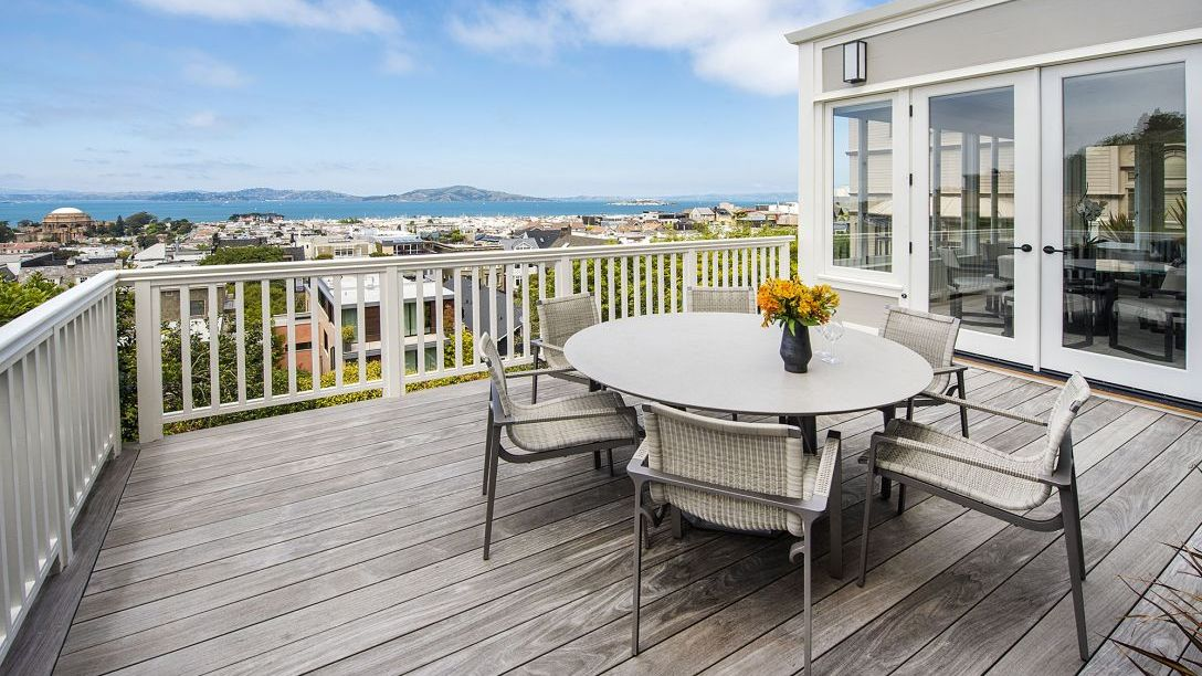 Table and chairs on deck of Pacific Heights remodel.