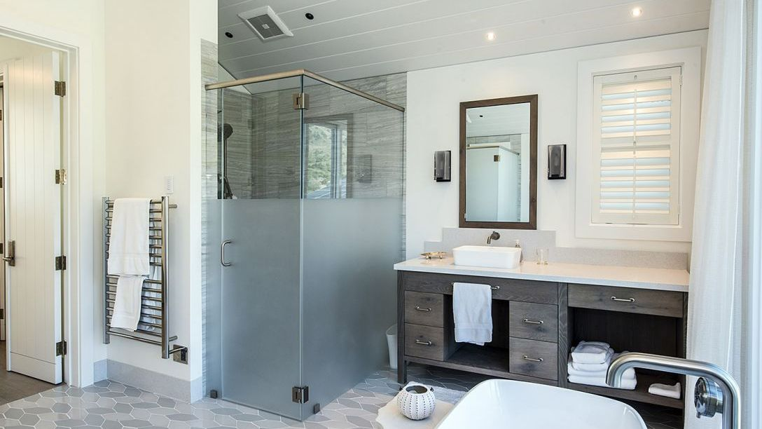 Master bathroom with white bathtub, and walk in shower.