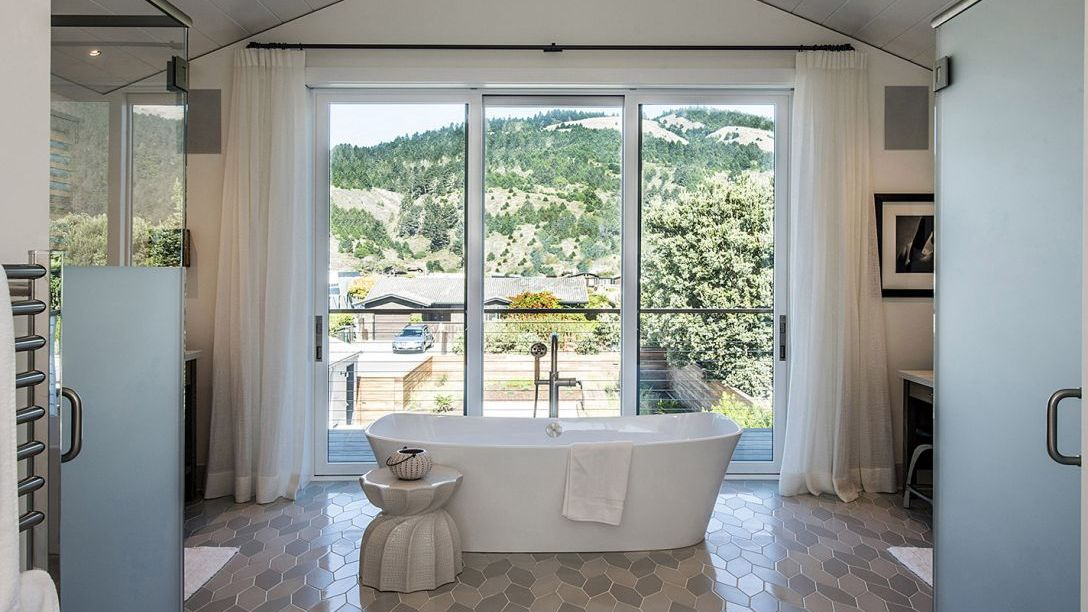 Master bathroom bathtub with balcony overlooking the Belvedere area.