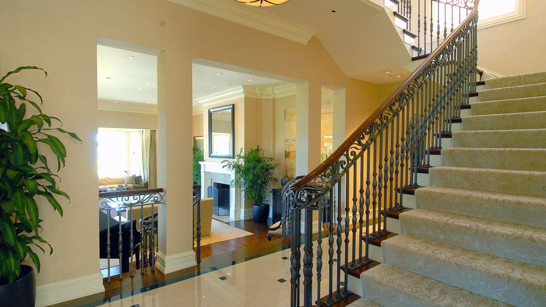 Stairs with wood railing.