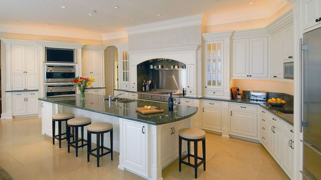 Kitchen with black marble countertops.