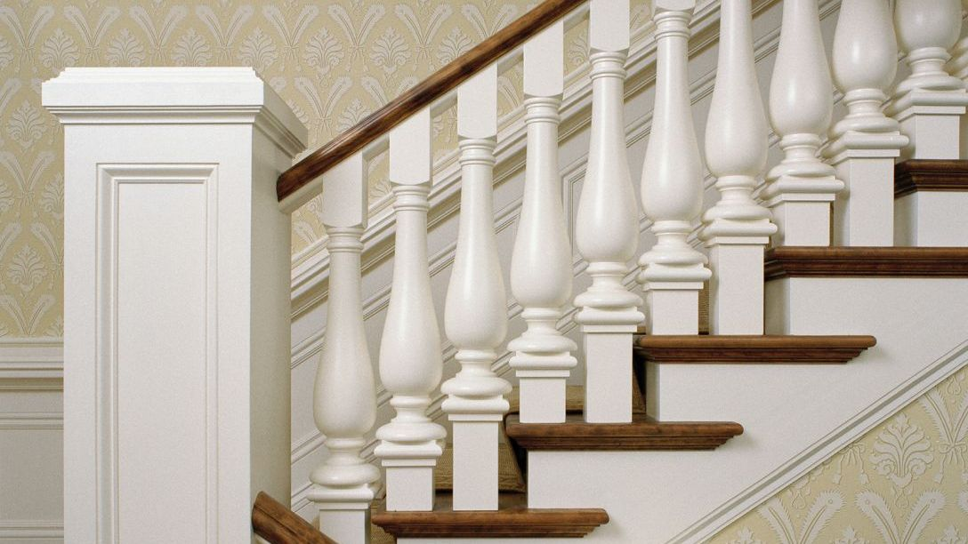 Stairs with white baluster and wood handrail and tread.