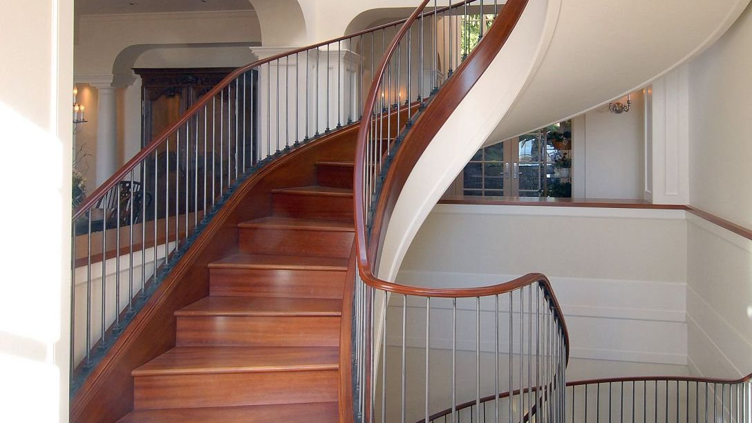 Bottom of wood spiral staircase.