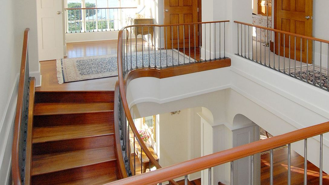 Top of wood stairs on second story.