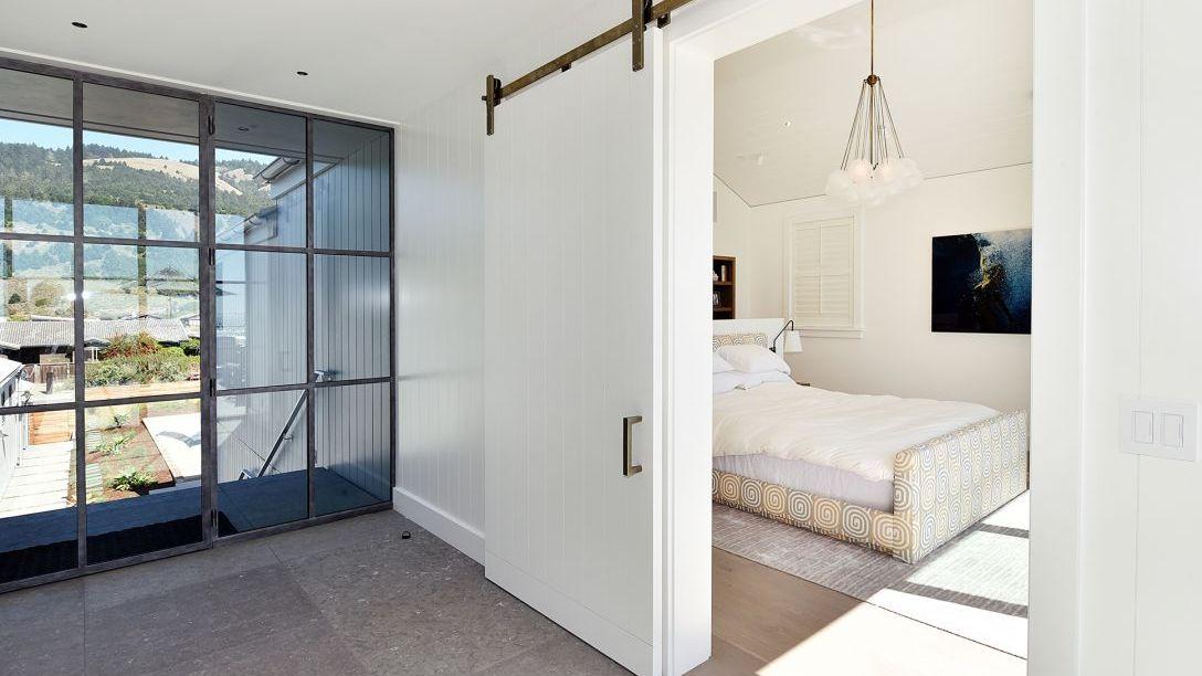 Bedroom with barn style door.