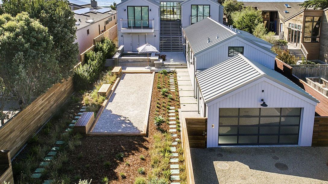 Front of Stinson Beach home with a garden and bocce ball court.