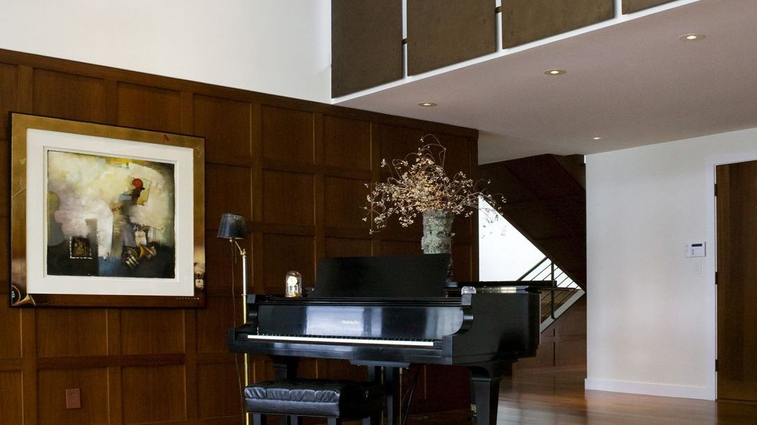 Baby grand piano in entryway of Water Front remodel.