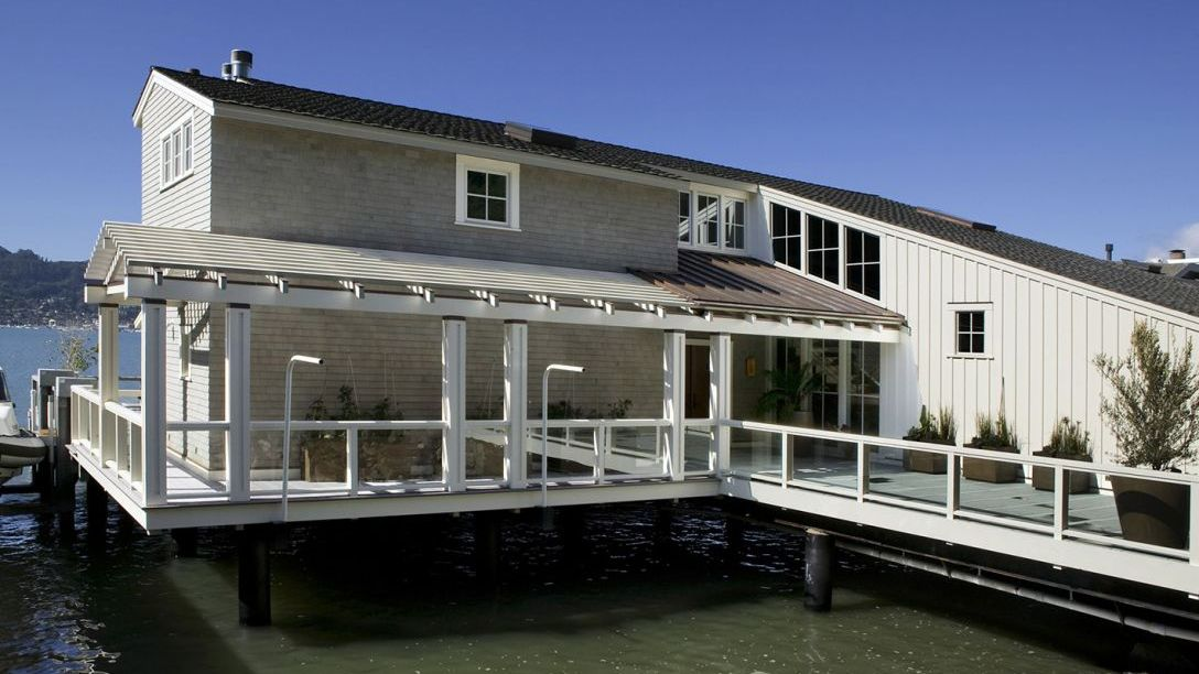 Two story Water Front remodel on the water held up by structural steel foundation.