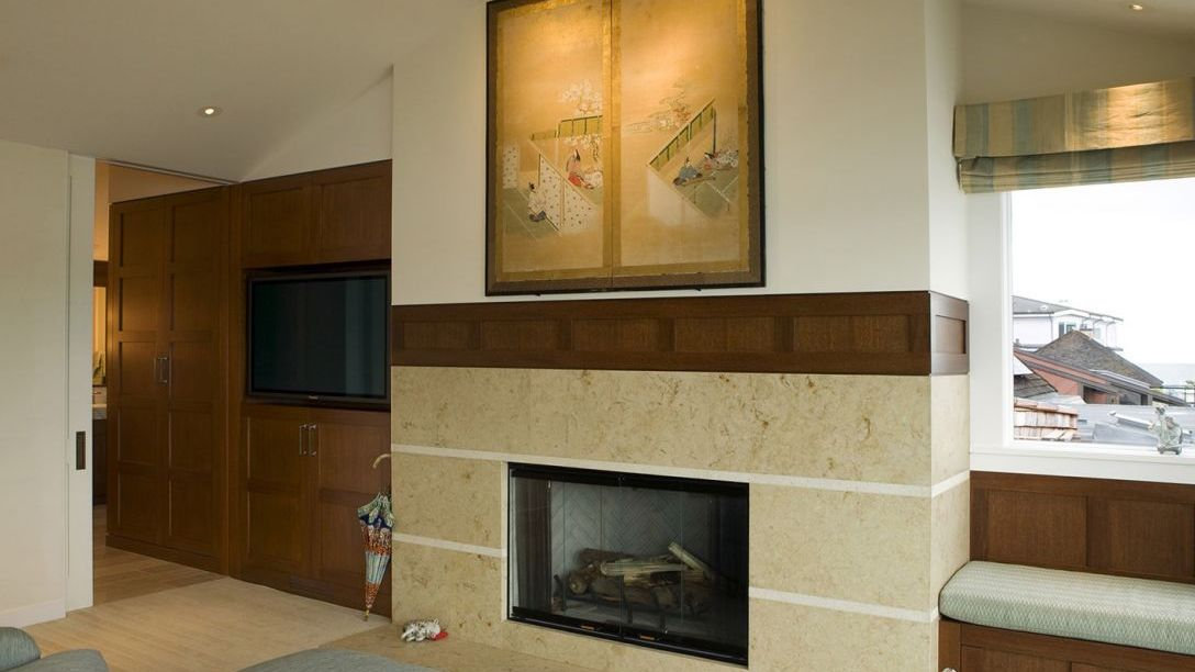 Room of Water Front remodel with mural above the fireplace and window overlooking the water.
