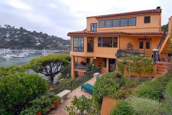 Spanish style 2 story home with a balcony overlooking the Bay.
