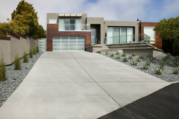 Cement driveway leading to garage of Tiburon Transformation Remodel.